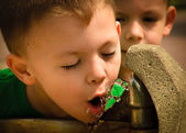 Boy drinking from fountain — Stock Photo