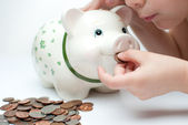 Kid with a piggy bank — Stock Photo