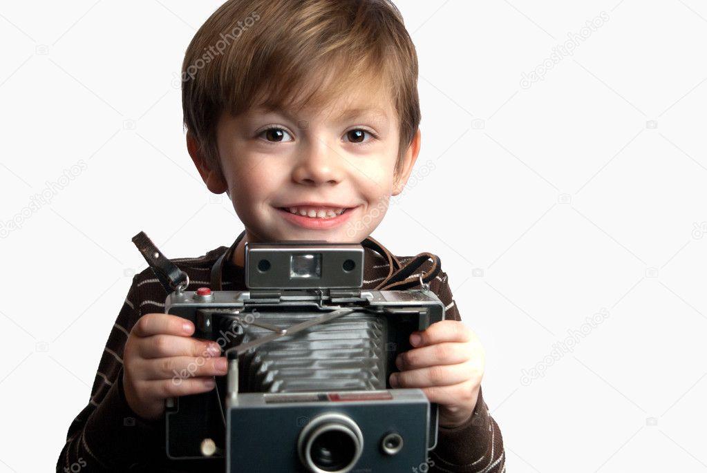 年轻的孩子拿着即时照相机在白色背景上 — 照片作者 greggeisenberg