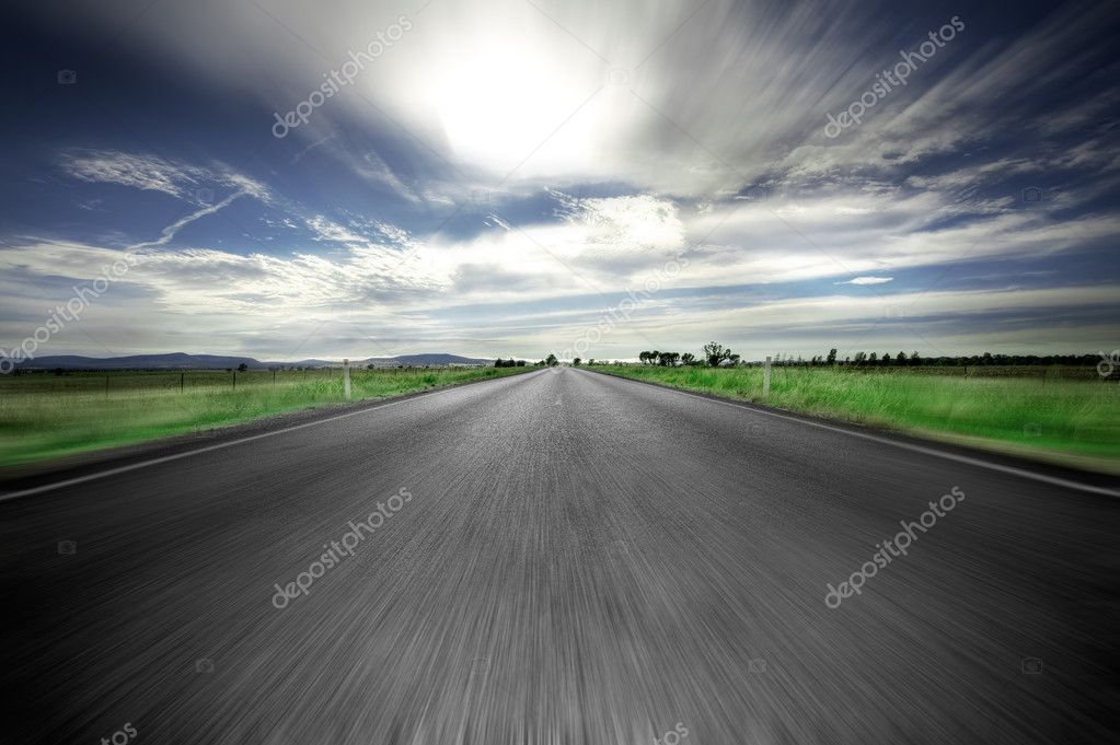 Road going straight ahead with motion blur — Stock Photo #10338183