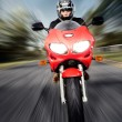 Stock Photo: Speed Motorbike rider with motion