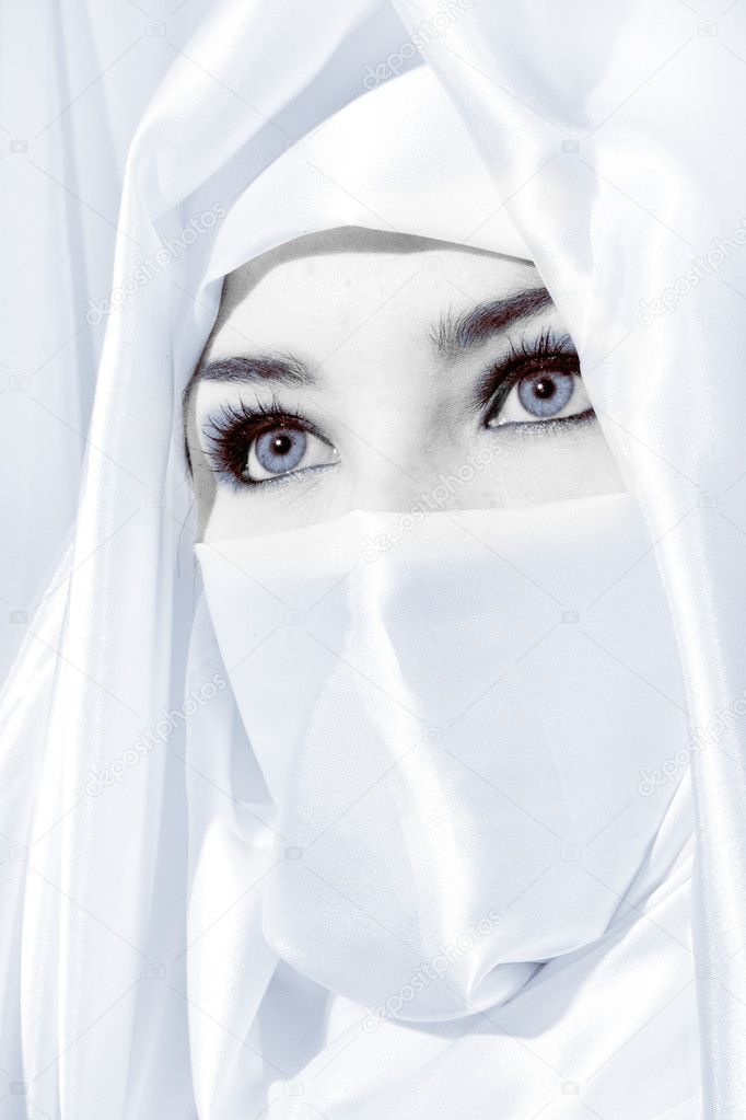 Close up face shot of woman in white face veil  Stock Photo #8855547
