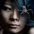 Portrait of model with spider in hair — Stock Photo
