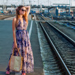 Girl waiting train on platform — Stock Photo #8121928