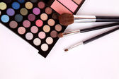 Makeup brushes and make-up eye shadows with blush — Stock Photo