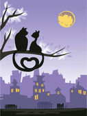 Two loving cats on a tree above the night city skyline. — Stock Vector