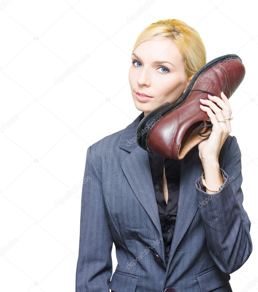 Undercover Spy Or Secret Agent Detective In Business Suit Holds Up A Large Shoe Telephone When Communicating As A Comical Clandestine Operative Of Espionage — 图库照片 #10020066