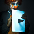 Stock Photo: Disturbed Clown With Knife