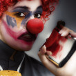 Clown Holding Flask - Stock Photo