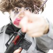 Pointing Crazed Lunatic - Stockfoto