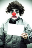 Unhappy Clown Holding Sign — Stock Photo