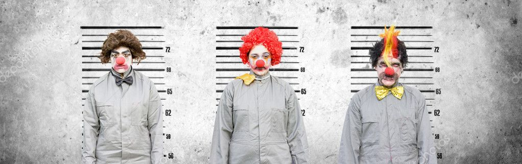 A Male And Two Female Clowns Who Face Criminal Charges Lineup Against A Cement Wall In An Attempt To Find Out The Criminal Amongst The Thugs In A Line Up Of The Usual Suspects  Stock Photo #10037378