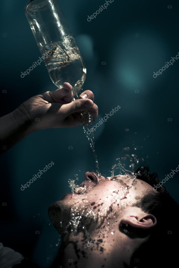 Falling Water Motion Action Capture On The Wet Face Of A Water Thirsty Man Needing A Summer Cool Down Drink Of Thirst Quenching H20 Water — Stock Photo #10037644