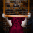 Ghost With Picture Frame - Stock Photo