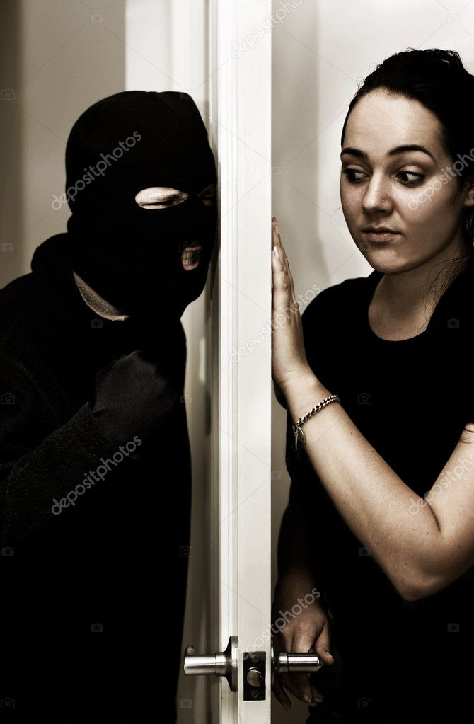 A Violent Intruder Bashes On A Door While A Female Occupant Hesitantly Opens Up — Stock Photo #10078128