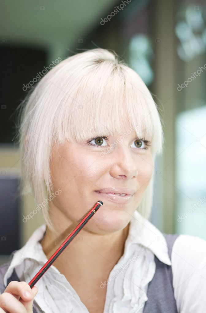 Female Office Worker Smiles While Contemplating A Lucrative Business Idea — Stock Photo #10080416