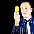 Stock Photo: Young mholding yellow bulb in his hand