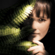 Woman Hiding Behind Fern Leaf — Stock Photo