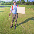 Golf Player Holding Sign — Stock Photo