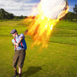 Burning Golf Ball - Stock Photo