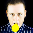 Young man with yellow bulb in his mouth — Stock Photo