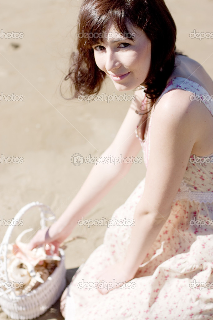 A Woman Visits The Great Outdoor To Collect Sea Shells And Discover The Beauty In Nature  Stock Photo #10105315