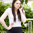 Unhappy Business Woman Talking On Cell Phone - Stock Photo