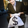 Happy Business Man Smiling With Money Bag - Stock Photo