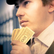 Man Holding Money Making A Financial Decision — Stock Photo #10155461