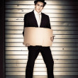 Full Body Vintage Man Holding Blank Cardboard Sign — Stock Photo #10155467
