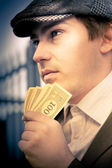 Man Holding Money Making A Financial Decision — Stock Photo