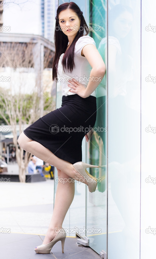 Portrait Of A Confident Young Career Smart Business Woman Opening An Office Glass Door With High Heel Shoe In A Door Of Opportunity And Development Concept — Stock Photo #10155335