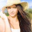 Stock Photo: Beautiful Beach Babe With Long Brunette Hair Wearing Hat