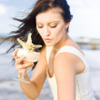 Woman Holding Star Fish Cocktail - Stock Photo