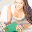 Smiling Person Relaxing With Book — Stockfoto