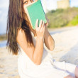 Stock Photo: Girl Holding Book