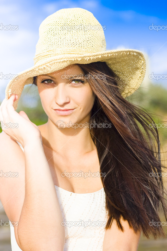 Portrait Of A Hot And Sexy Wind Swept Beach Babe Wearing Hat With Beautiful Blue Sky In The Background.  Stock Photo #10220651