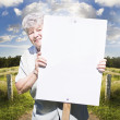 Stock Photo: Senior WomWith Blank Sign