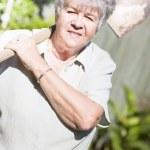 Gardening Grandmother — Stock Photo