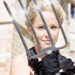 Woman Giving The Garden Forks — Stock Photo