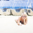 Woman Sunbathing On Beach — Stock Photo