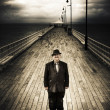 Senior Male Standing On A Pier Promenade - Stock Photo