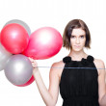 Elegant Woman Holding Balloons — Stock Photo
