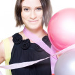 Party Girl Draped In Party Balloons And Streamers - Stock Photo
