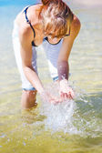 Female Traveler Playing In Shallow Water — Stock Photo