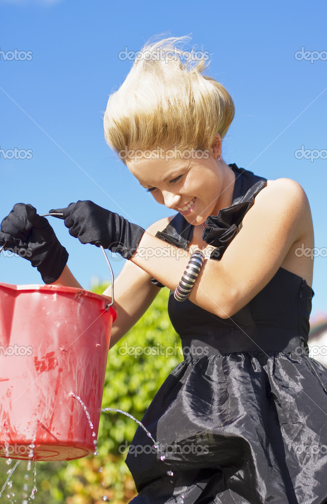 Laughing Woman Holding A Leaking Bucket With Many Holes  Stock Photo #10263135