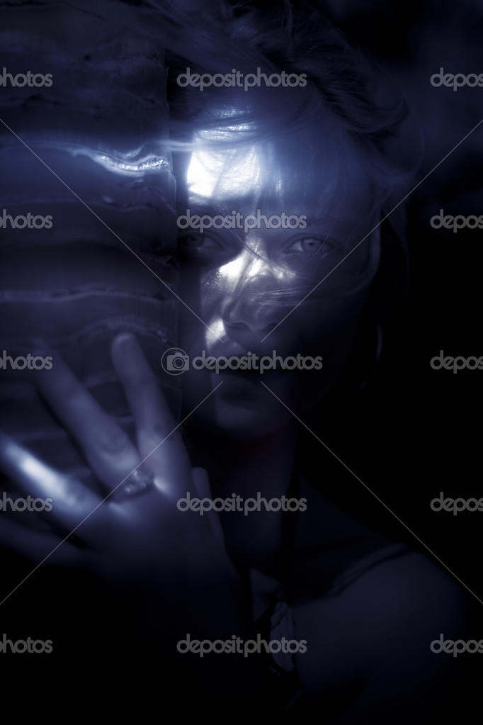 Woman Hiding Behind A Tree Trunk With Hand During Nighttime, In Blue Monotone — Stock Photo #10263828