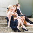 Three Young Attractive Woman Sitting On Steps — Stock Photo