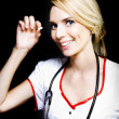 Smiling nurse with a pill for a patient — Stockfoto