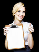 Beautiful woman holding blank clipboard — Stock Photo